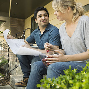 Couple looking at home plans