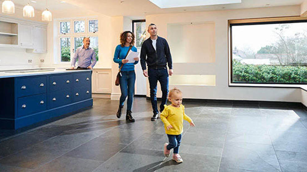 Real estate agent taking a picture of the bathroom