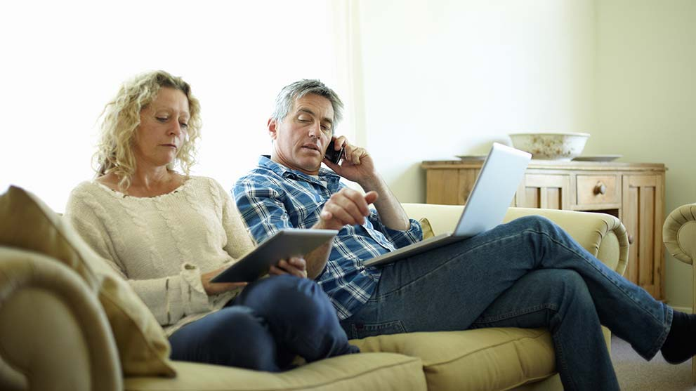 husband and wife read about foreclosure scams
