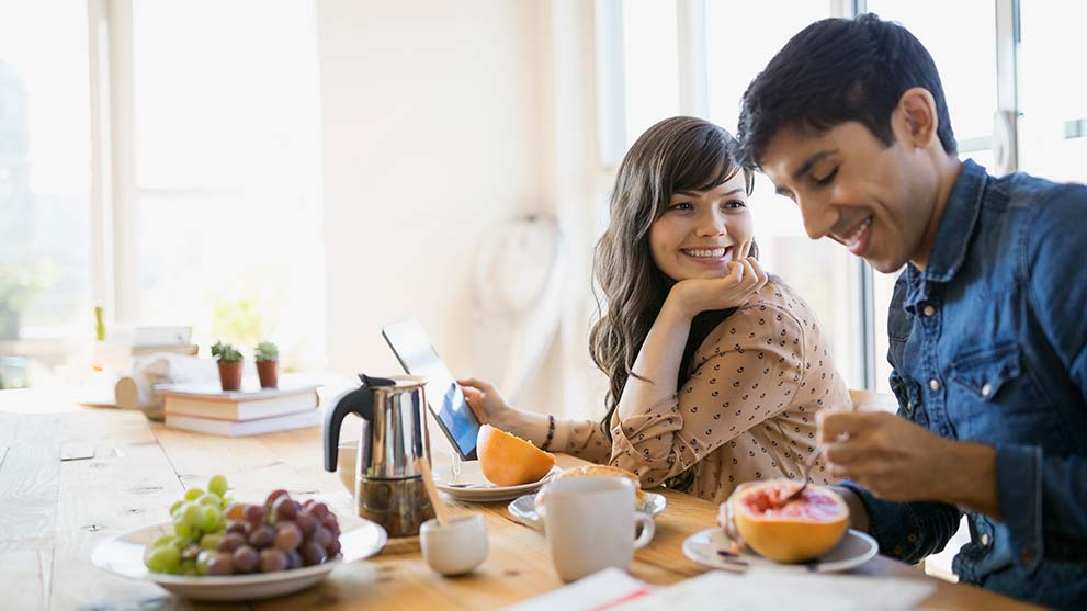 young couple enjoy breakfast together