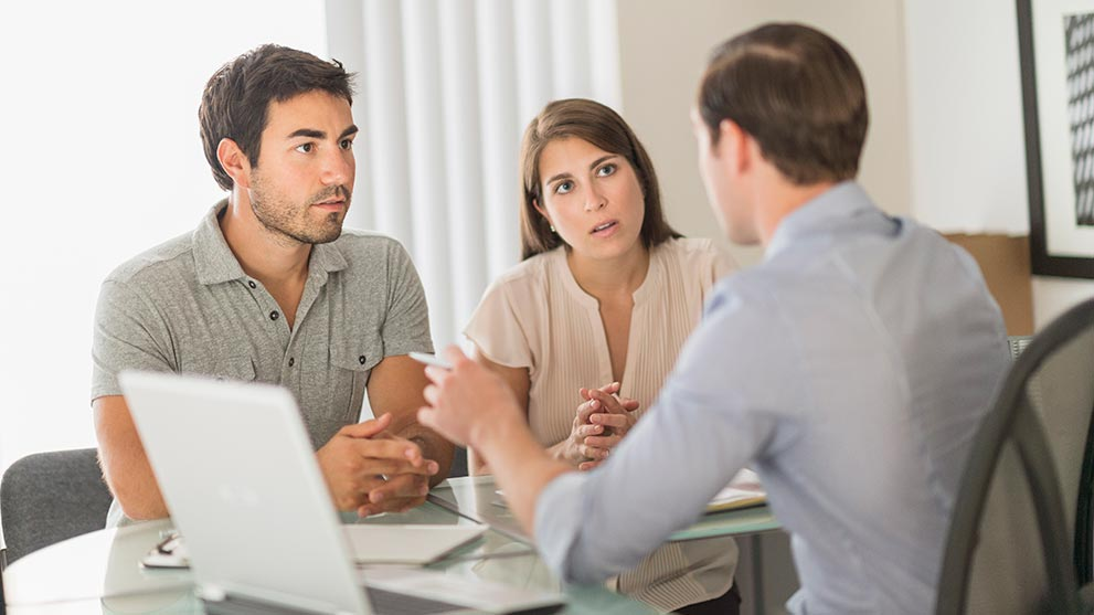 married couple discusses loan modification options