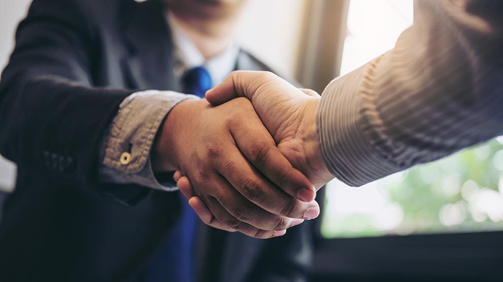 client shaking hands with agent