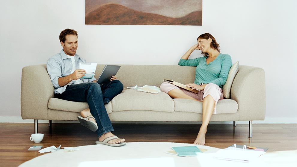 man and woman discussing the escrow process