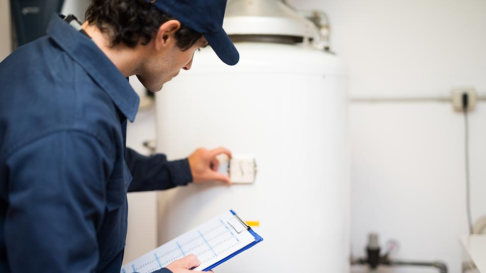 home inspector checking water heater