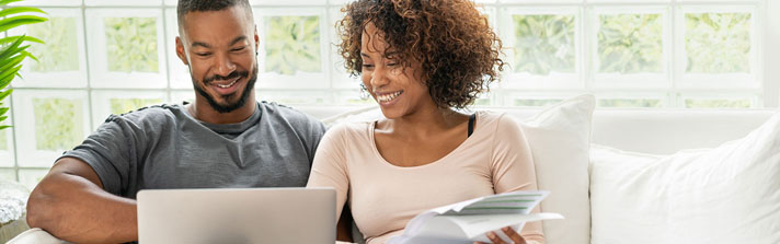 happy couple creating a savings plan