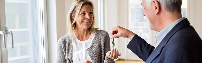 Woman receiving keys to the condo