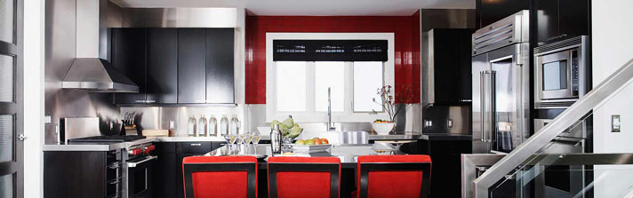 Modern kitchen with black cabinets and red accents
