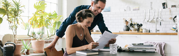 married couple excited about good tax information