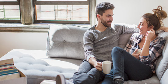 couple on a sofa with coffee
