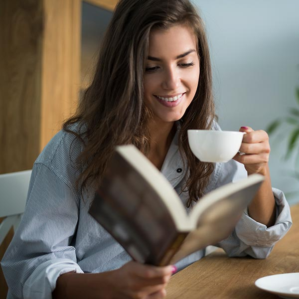 women reading with coffee