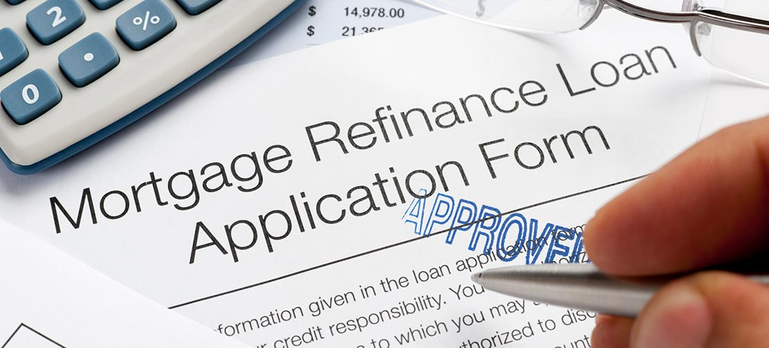 Woman refinances thanks to record breaking low rates.