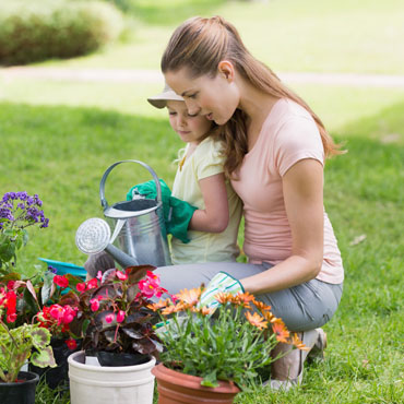 Mother gardening with her daughter.