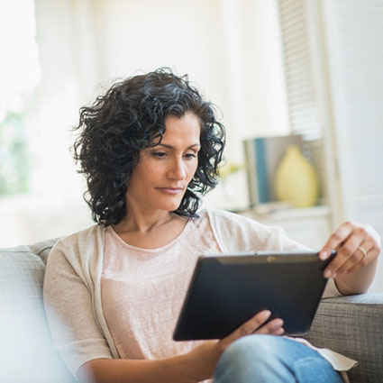 Woman studying tablet computer