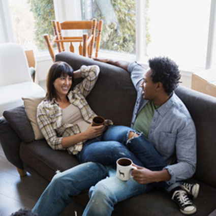 Couple sitting on sofa