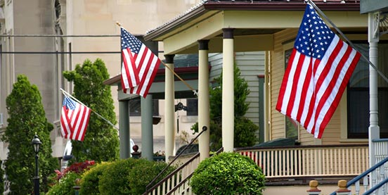 homes with American flags in front