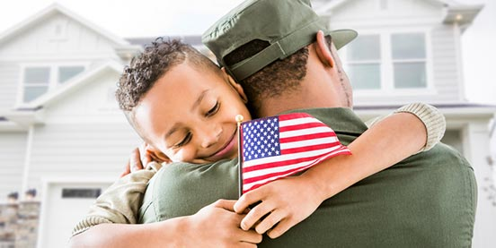 son hugging veteran dad